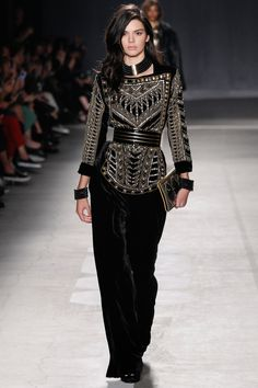 See all of the looks from the Balmain x H&M fashion show here.