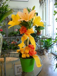 Sweet Springtime Topiary by Texas Blooms (yellow and apricot lilies, orange and yellow roses)