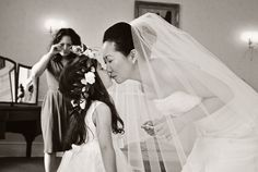 Bridesmaid kiss. Look at her mother in the background. What a precious moment. #bucklandtoutsaints #flowergirl #moments