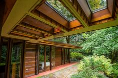 "10/9/2012--Sammamish, WA, USA..VIEW: Exterior showing rear of house with bedrooms on small, paved veranda...Architect Frank Lloyd Wright planned his ""Usonian"" homes to be affordable for middle-class families. The 1,9500 square foot Brandes home is for sale in Sammamish, Washington (30 minutes from Seattle) at $1.39 million. It features three bedrooms, two bathrooms and a small, separate office/study space...The home was built in 1952, and has redwood trim and Wright's original furniture and…"