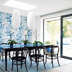 Botanical-dining-room-with-black-furniture-carpet-floral-walls-and-decorations   - blue and green