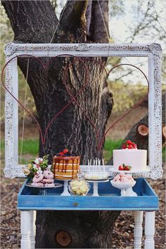Dessert table ideas with framed hearts backdrop. Cake Design: M Cakes Sweets ---> http://www.weddingchicks.com/2014/05/28/springtime-soiree-for-your-besties/