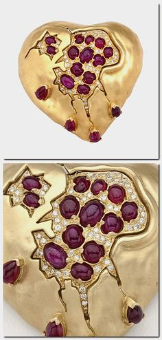"""Pomegranate Heart  Salvador Dali  """"The """"Pomegranate Heart"""" was designed by Dali in the 1950's with rubies and diamonds. This example was fabricated by Henryk Kaston who made all of Dali's jewelry from 1980 to 1990. The stones include 17 pear shaped and oval cabochon cut rubies, for a total weight of 6.44 carats. The brooch is further highlighted by 63 full cut round diamonds for a total weight of .63 carats."""