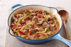 Your new favorite one-skillet steak recipe has strips of top round and fresh onions and peppers in a simple-to-make cheesy sauce.