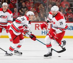 Sebastian Aho Photos Photos - Sebastian Aho #20 of the Carolina Hurricanes circles at center ice with the puck as he skates around teammates in an NHL hockey game against the New Jersey Devils at the Prudential Center on November 8, 2016 in Newark, New Jersey. Devils won 3-2 in a shootout. - Carolina Hurricanes v New Jersey Devils