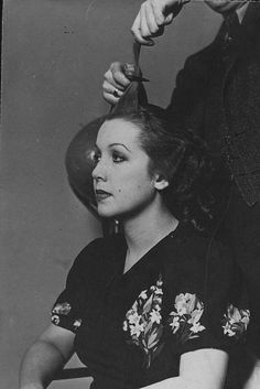 A 1930s woman (in a pretty floral print dress) having her hair styled. #vintage #1930s #hair #hairdresser
