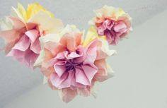 Spring tissue paper garland - I'm thinking I could do this with scrap fabric, too.