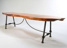 Very nice forged table with rustic polished top.