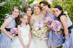 Dusty blue bridesmaids with purple or pink inspired bouquets