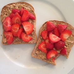 Whole wheat toast with peanut butter and strawberries
