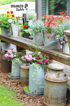 Colorful Corner: Need an easy way to add color to an overlooked corner your backyard? Old milks cans, chicken feeders, and galvanized mop buckets are just itching for new life as planters.