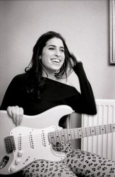 Amy bought her first guitar when she was 14 and began writing music a year later. Soon after, she began working for a living, including, at one time, as an entertainment journalist for the World Entertainment News Network, in addition to singing with local group the Bolsha Band. In July 2000, she became the featured female vocalist with the National Youth Jazz Orchestra.