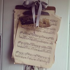Front door decor..An old clip board with vintage sheet music & photographs..