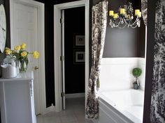 small bathroom redo...black walls, toile shower curtain, and splashes of yellow