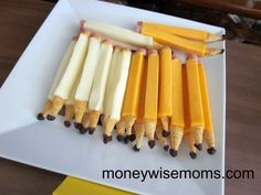 """String Cheese Pencils        Mozarella or Colby String Cheese sticks      1/2 inch-thick slices of bologna      Mustard      Bugles Corn Snacks      Raisins        For each pencil, cut one end of a cheese stick to make it flat. Cut a small circle out of the bologna and attach it to the end of the """"pencil"""" with mustard. Press the end of a Bugle into the other end of the cheese stick, then attach the raisin (either with mustard or by pressing it into the Bugle)."""
