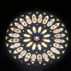 The Rose Window - A Stained Glass Phoenix Rising From the Ashes: The Rose Window, a stained glass masterpiece high in the South Transept of York Minster, was nearly lost after lightning struck the Minster in the 1980s causing a severe fire in the Minster's wooden roof. The stonework of the Rose Window was completed in the mid 13th century but the stained glass was added near the end of the 15th century to commemorate the end of the War of the Roses and honor the Tudor dynasty.