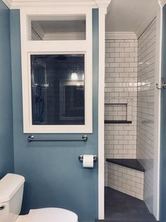 Master Bathroom - Custom half-wall doorless open shower - White subway tile - Smoke grey window - Concrete