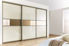 Curved Bronze Frame with Pearl White Glass & Bronze Mirrors. Design your own Sliding Wardrobe Doors here: http://www.diyhomefit.co.uk/bedrooms/sliding-wardrobe-doors-designer.html