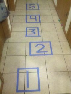 Indoor hop scotch makes teaching numbers easy!~Do with larger numbers