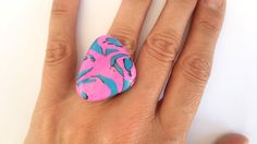 Handmade polymer clay abstract ring with an adjustable silver toned metal ring base.