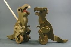 T Rex Wooden Toy: Push it along as the limbs move and the mouth opens and closes! $49.75.