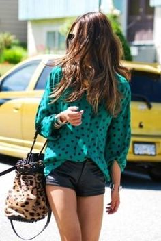 Leather shorts and polka dot blouse.