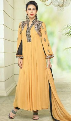Stand a class apart like Karisma Kapoor in this yellow color georgette Anarkali suit. The charming lace, patch and resham work a substantial characteristic of this attire. #fancypakistanisuits #bollywoodactressdresses #georgettesuitscollection