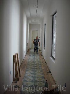 La Espanola Cement Tile in an Art Gallery Hallway with Hardwood Borders.