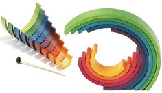 "Rainbow wooden ""toy"" art by Naef. Curved blocks that create sculptural art. On sale at Fat Brain Toys for $168. So cool."