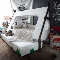 Just fall in love with Sarah of Hello Bowsers' handmade teepee tent bed for her son, and it looks awesome. It has a slide out bunk for sleep-overs and we love the child room #decor. #design #creative #childrensroom #stylishliving