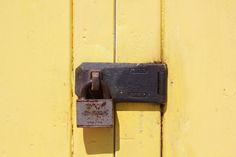 Yellow beach hut padlock
