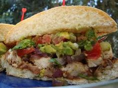 Try Average Betty's twist on the Torta! Grilled chicken, refried beans, cotija cheese, grilled red onion and avocado relish piled high inside soft, grilled Telera. Chicken Recipes, Grilled Chicken, Mexican Sandwich, Wraps, Refried Beans, Wrap Sandwiches, Mexican Food Recipes, Cheesesteak, Seafood