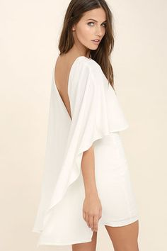Things are looking up with items like the Best is Yet to Come White Backless Dress making their way into your wardrobe! A unique, backless silhouette is created by woven poly fabric that drapes into a front tier, and cape sleeves that trail alongside the sheath skirt. Hidden back zipper.