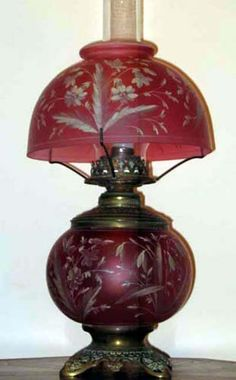 Victorian enameled Cranberry table lamp, originally made for kerosene now electrified. Antique Hurricane Lamps, Antique Oil Lamps, Old Lamps, Vintage Lamps, Victorian Lighting, Victorian Lamps, Antique Lighting, Victorian Era, Chandelier Lamp