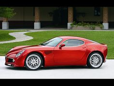 Alfa Romeo 8C, ALWAYS have had a thing for Alfa Romeo's. Saw this one in South Africa at a vineyard last year