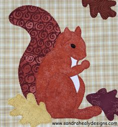 Check out the September block of Sandra Healy Designs Calendar Quilt. This block features an adorable applique squirrel and some simple piecing. Fall Applique, Applique Quilt Patterns, Creeper Minecraft, Embroidery Designs, Quilting Designs, Drawstring Bag Pattern, Fall Quilts, Animal Quilts, Traditional Quilts