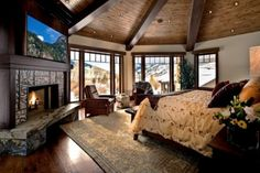 A tudor inspired master bedroom, great ceiling wood detail! Love the fireplace, wish it was a stone exterior, rather than the marble looking one there.