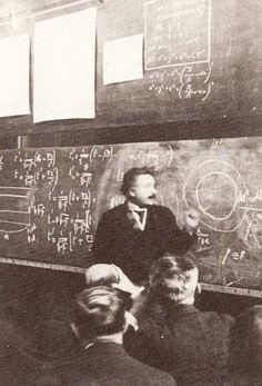 Einstein in early 1900's demonstrating one of his theories.