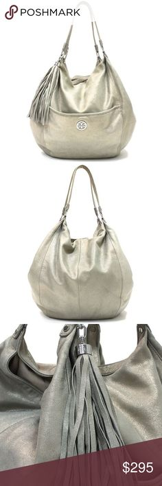 Tory Burch Gold Metallic Leather Hobo Bag Authentic Tory Burch gold metallic leather bag. Has silver hardware, front pocket with magnetic closure and leather tassel. Size 12x13x7 Tory Burch Bags Hobos