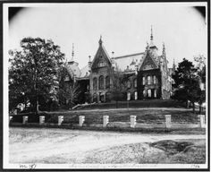 """The Old Main building on the campus of Sam Houston State University. This photograph was taken in 1922. One described as the """"most beautiful building owned by the State of Texas,"""" it was a two story Victorian Gothic building which contained classrooms, admin offices, and an auditorium.  Old Main no longer stands; it burned down in 1982."""