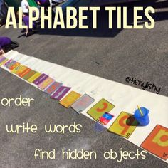 Alphabet tiles. Children ordered and wrote words beginning with ?