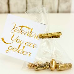 Create this Glamours Golden Valentine with gold glitter pills and a free printable. Its a perfect gift for any loved one to let them know they are special.