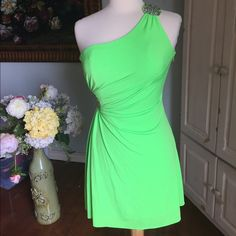 "Hostess  Pick Gorgeous brilliant green dress from Macy's. Juniors size 7/8. Which is women's 2/4.  16"" pit to pit   14"" waist. 35"" length.  Preloved. Small dot on side but hard to see. Ask questions and let me know if you are interested  Hailey Logan Dresses Prom"