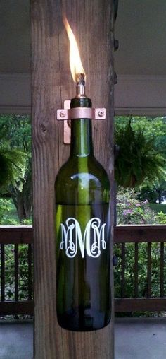 "The monogrammed lantern is made from a recycled wine bottle. This lantern will light your way on any dark night or get rid of those pesky bugs when burning citronella. The lantern makes a great gift for the ""green"" person in your family, or for anyone who"