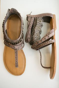 Slip on these beautiful gladiator sandals for the new season. These taupe sandals feature a hidden zipper, thong strip, and gold embellishments. Each pair includes handcrafted details which may have v