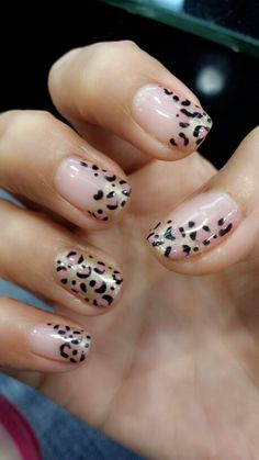 "Leopard nails: only one or two nails with leopard. Use free edge gel to do ""natural nails"" . Leopard spots in black and a coral/gold mix. Add gold"