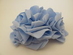 http://www.lovecityblog.com/2010/11/fabric-flower-bouquet-tutorial-giveaway.html