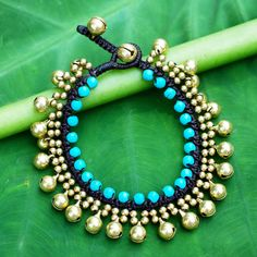NOVICA Handcrafted Turquoise Blue Calcite and Brass Bracelet ($24) ❤ liked on Polyvore featuring jewelry, bracelets, brass, cord, brown jewelry, blue turquoise jewelry, braid jewelry, brass bangles and turquoise blue jewellery