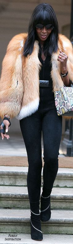 Naomi Campbell  Does a lot of belting at the smallest part of waist and wearing a longer jacket over