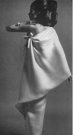 Gloria Friedrich in an elegant white crepe evening dress by Givenchy, photo by William Klein for Vogue 1967